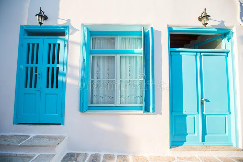 Traditional houses withe blue doors in the narrow streets of Mykonos, Greece. Traditional houses in the narrow streets of Mykonos, Greece royalty free stock photos