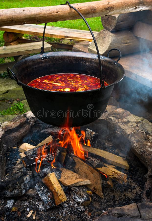 Traditional Hungarian Goulash soup in cauldron stock photo