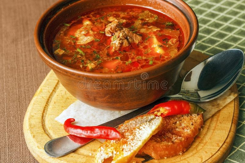 Traditional Hungarian goulash soup. Bogracs close-up in a bowl on royalty free stock photos
