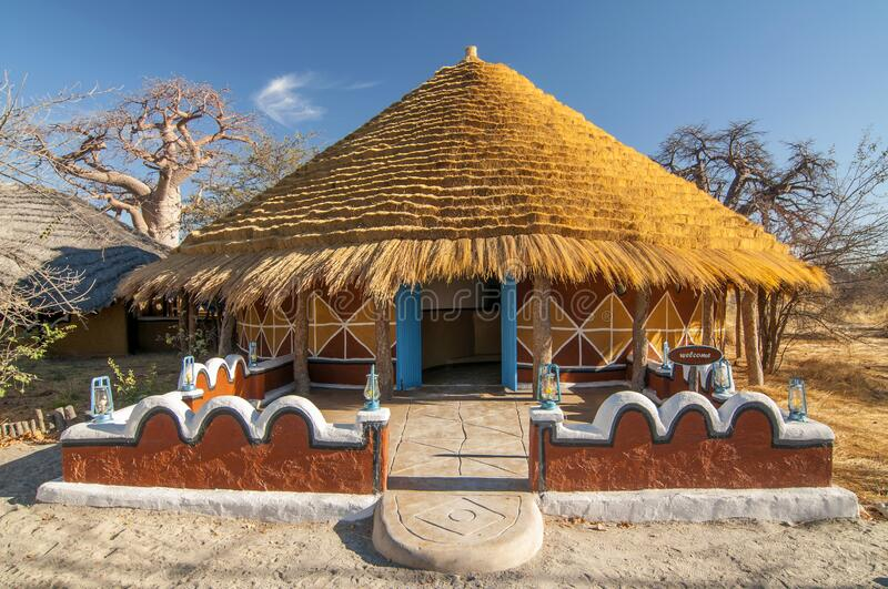 Traditional hut accommodation at Planet Baobab in Botswana, Africa.  stock photo