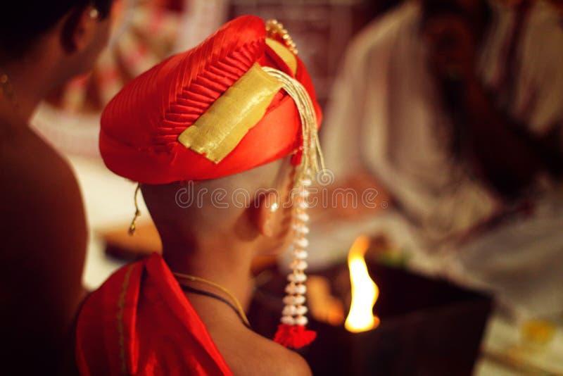 Traditional Indian Brahmin Threading ceremony. A kid is experiencing Traditional Indian Brahmin Threading ceremony royalty free stock image