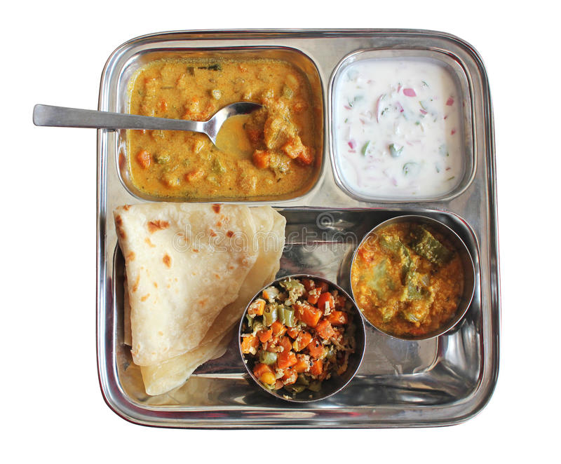 Traditional Indian chapati with curries, raitha stock images