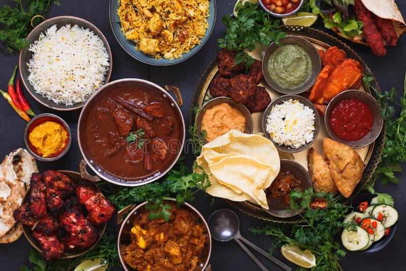 Traditional Indian dishes and snacks  in an authentic copper  serving bowls royalty free stock photo