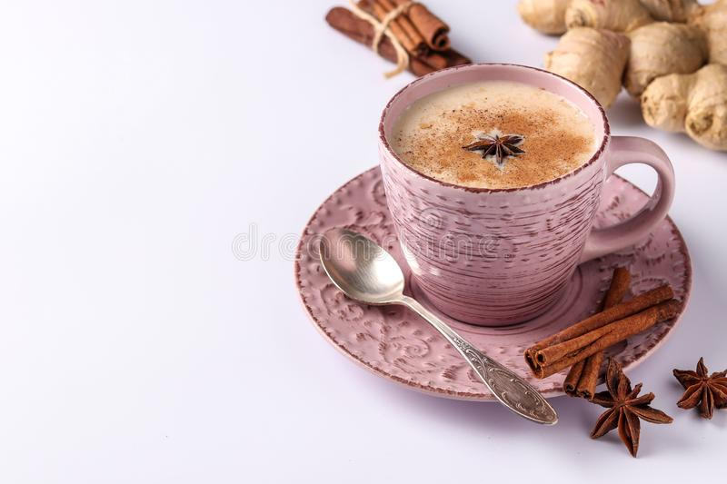 Traditional indian drink - masala tea with spices on a white background, horizontal orientation, copy space. Close-up stock photography
