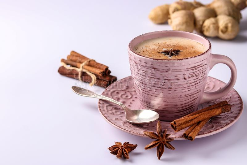 Traditional indian drink - masala tea with spices on a white background, horizontal orientation, copy space. Close-up royalty free stock image