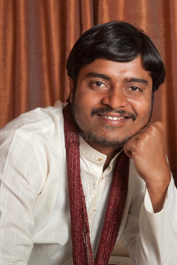 Traditional Indian man. A young Indian man in traditional ethnic wear stock images