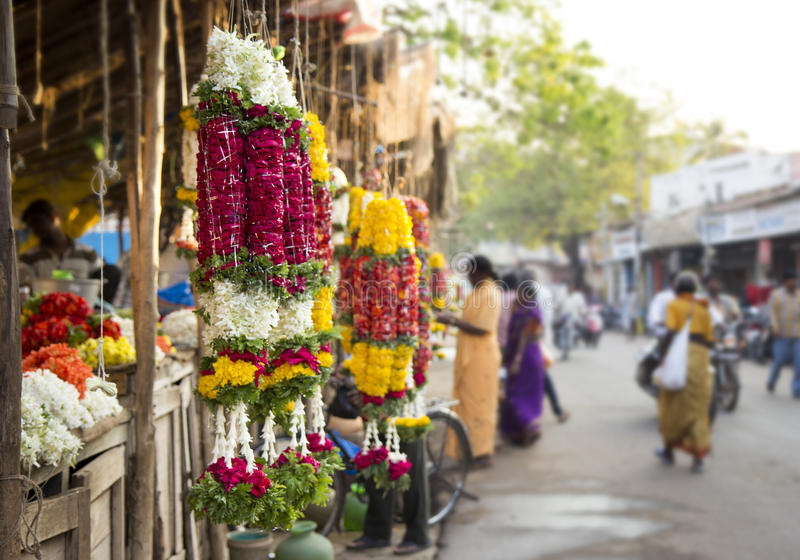 Traditional indian marigold flower garlands in a market place stock image