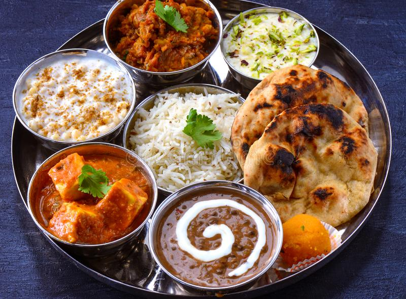 Traditional Indian meals -punjabi vegetarian main course. Indian meal or Thaali consisting of different curries like shahi paneer cottage cheese curry,tandoori stock photography
