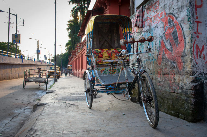 Traditional indian rickshaw. KOLKATA (CALCUTTA), INDIA - OCTOBER 06: Traditional indian rickshaw parked on the street on October 06, 2014 in Kolkata, India royalty free stock images