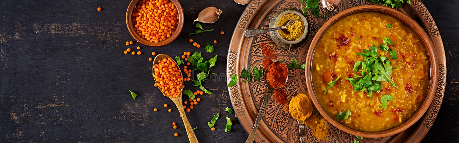 Traditional Indian soup lentils. Indian Dhal spicy curry in bowl, spices, herbs royalty free stock image