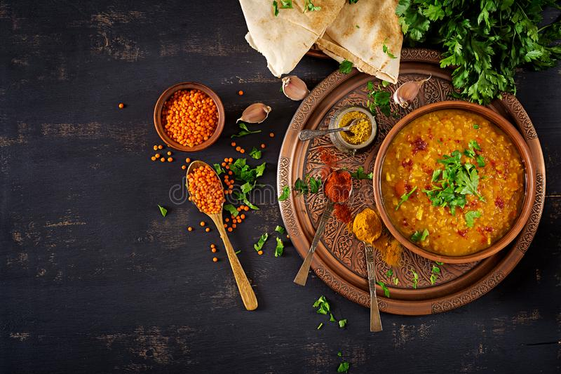 Traditional Indian soup lentils. Indian Dhal spicy curry in bowl, spices, herbs stock images
