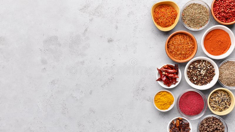 Traditional Indian spices in bowls on grey background royalty free stock photos