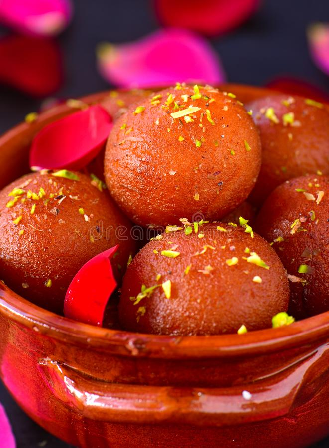 Traditional Indian sweet -Gulab Jamun. Gulab Jamun is a traditional Indian dessert which is made out of milk powder truffles dunked in sugar syrup.They may or royalty free stock images