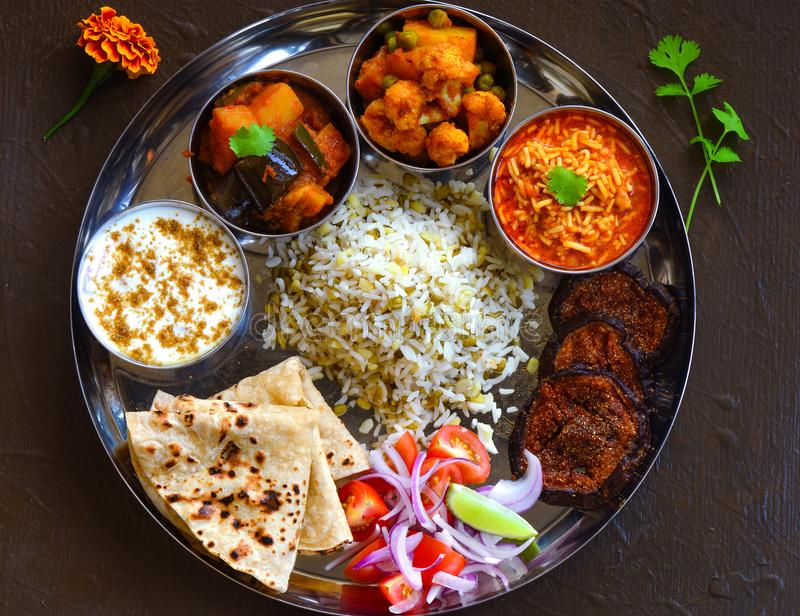 Traditional Indian Thali or Indian meal. Indian meal or Thaali consisting of different curries like sev tomato na shak,aloo gobhicauliflower curry,aloo royalty free stock image