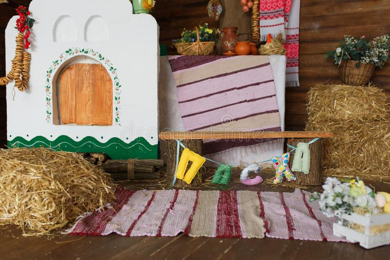 Traditional interior of the ancient Ukrainian hut. Decorated for easter holiday with straw and eggs royalty free stock photo