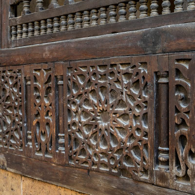 Traditional interleaved wooden decorated arabesque unit, Old Cairo, Egypt. Traditional interleaved wooden decorated arabesque unit, Facade of Beit El Sehemy royalty free stock image