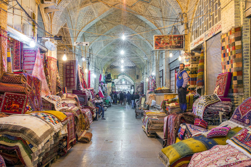 Traditional iranian carpets shop in Vakil Bazaar, Shiraz, Iran. Shiraz, Iran - December 24, 2015: Traditional iranian carpets shop in Vakil Bazaar, Shiraz, Iran royalty free stock image