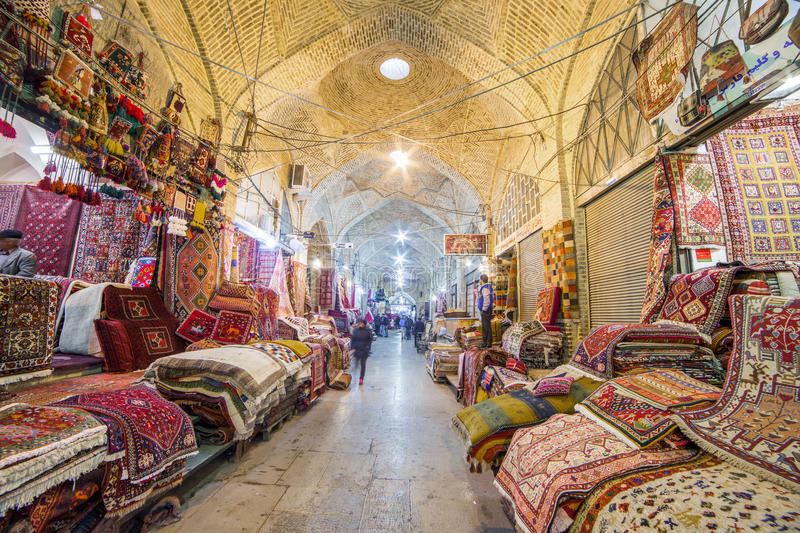 Traditional iranian carpets shop in Vakil Bazaar, Shiraz, Iran. Shiraz, Iran - December 24, 2015: Traditional iranian carpets shop in Vakil Bazaar, Shiraz, Iran stock photography