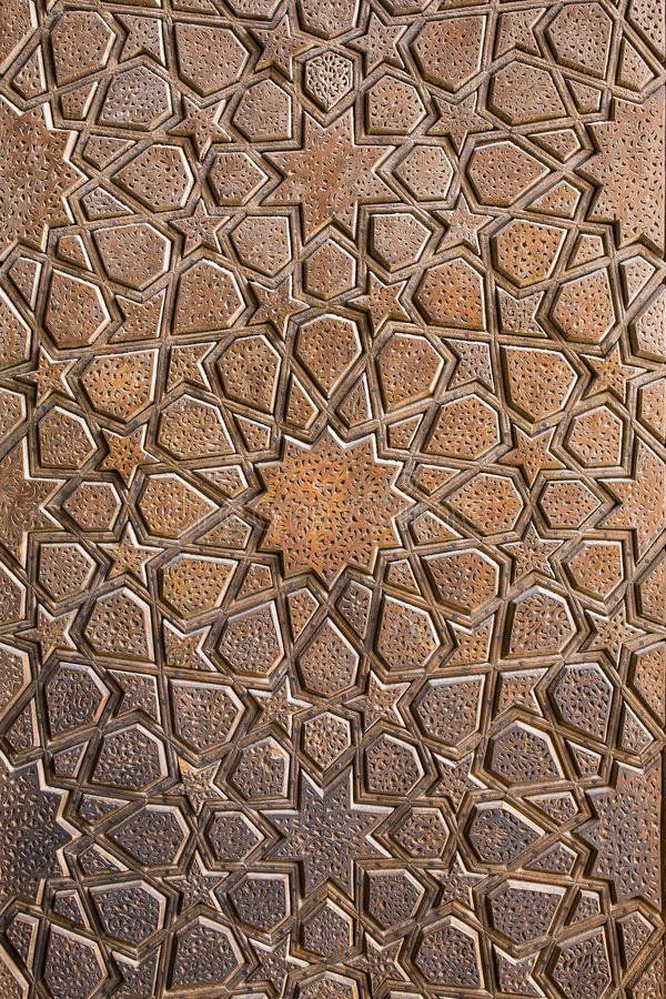 Traditional Iranian ornament on wooden door. Of Jameh mosque in Yazd, Iran royalty free stock image