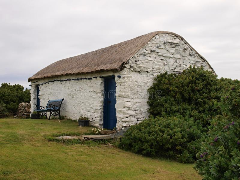 Traditional Irish house. Typical northern Ireland house, with thatch roof situated close to Malin Head - Ireland stock photography