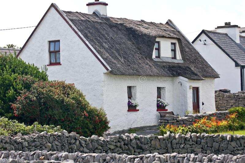 Traditional Irish house, Inisheer, Ireland. Traditional white stone house with thatched roof, Inis Oirr, Aran Island, Ireland royalty free stock photography