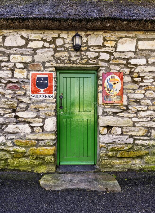 Traditional Irish pub door with original signs stock images