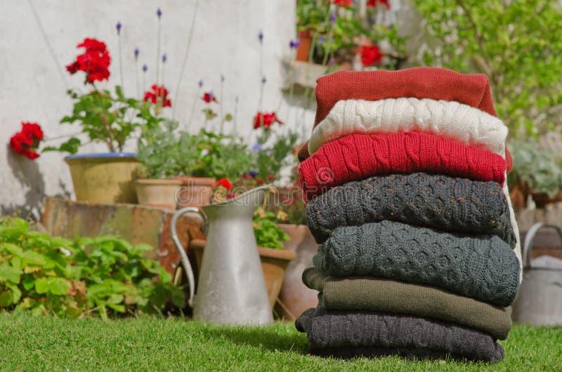Traditional Irish wool men's winter sweaters stock images