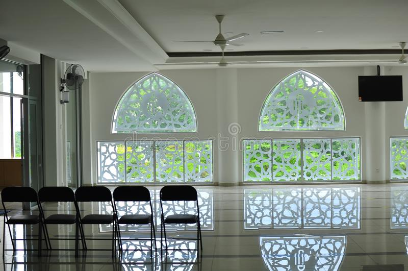 Traditional Islamic geometric pattern of a mosque in Bandar Baru Bangi. Modern and Unique Islamic Geometric pattern of a mosque wall with its reflections on the stock photography