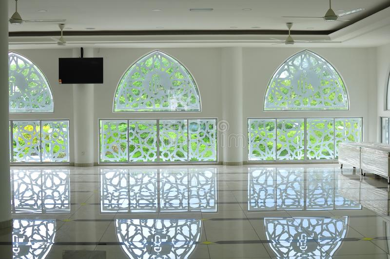 Traditional Islamic geometric pattern of a mosque in Bandar Baru Bangi. Modern and Unique Islamic Geometric pattern of a mosque wall with its reflections on the stock image