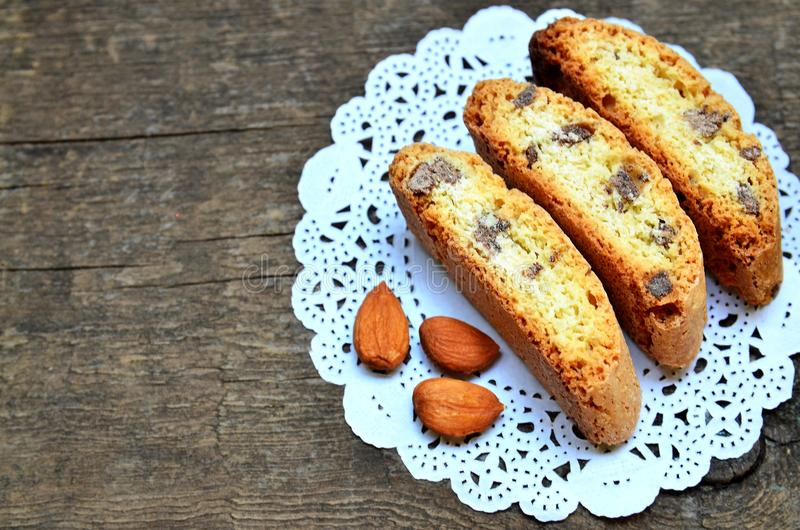 Traditional italian cantuccini almond cookies on old wooden background.Delicious homemade cantucci biscotti. Selective focus royalty free stock photography