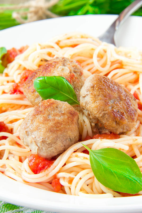 Traditional Italian dish of spaghetti with tomato sauce and meat. Balls in white plate stock image