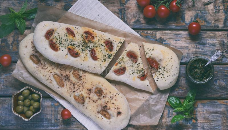 Traditional Italian Focaccia with tomatoes, basil, garlic and sumach. Homemade pastry. Flat bread. Organic flatbread. Rustic style. Traditional Italian Focaccia stock images