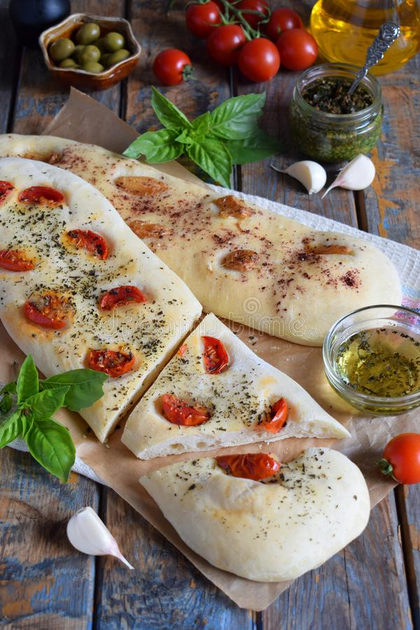 Traditional Italian Focaccia with tomatoes, basil, garlic and sumach. Homemade pastry. Flat bread. Organic flatbread. Rustic style. The traditional Italian stock photography