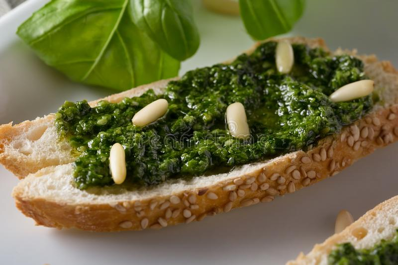 Traditional Italian Fresh sandwich with pesto genovese, selective soft focus royalty free stock photos