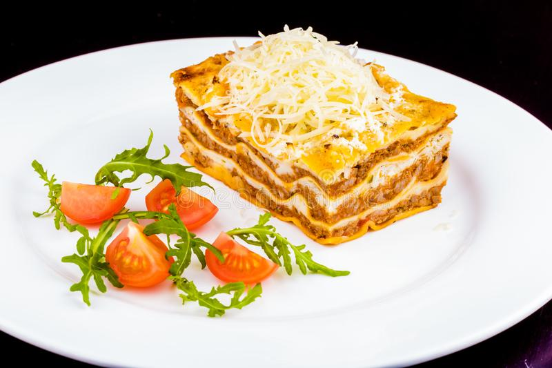 Traditional italian lasagna with beef meat on white plate stock image