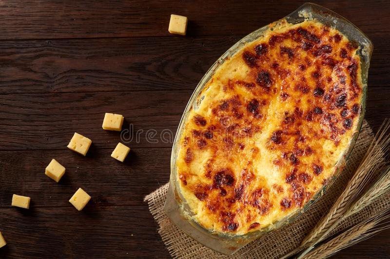 Traditional Italian lasagna cooked in a glass pan over vintage wooden background, top view, close-up, selective focus royalty free stock photography