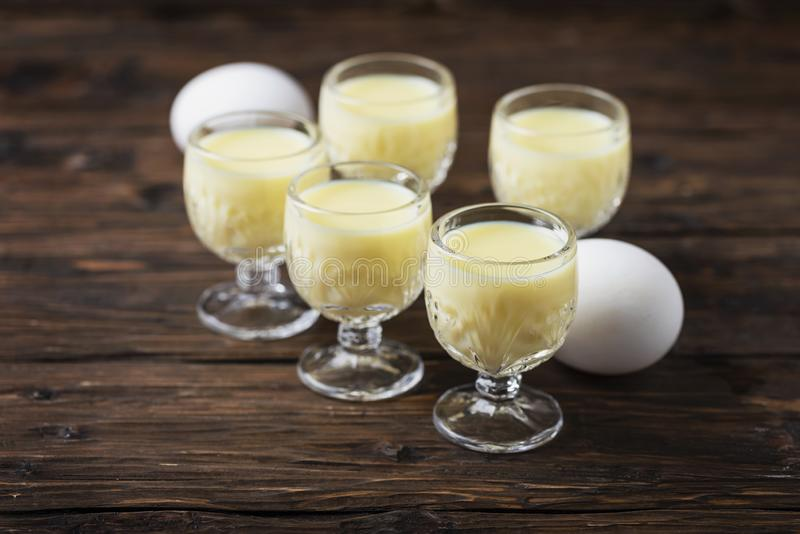 Traditional Italian liquor Vov with eggs. Rustic style and selective focus image royalty free stock images