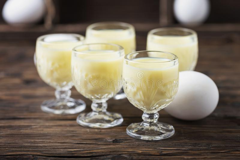 Traditional Italian liquor Vov with eggs. Rustic style and selective focus image stock photography