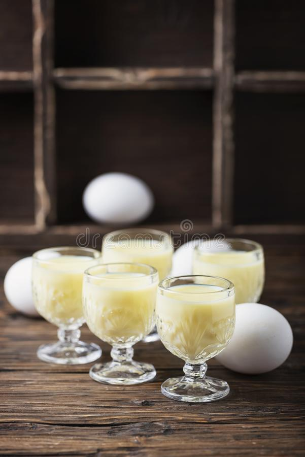 Traditional Italian liquor Vov with eggs. Rustic style and selective focus image stock photo