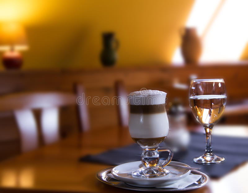 Traditional Italian macchiato with caramel in coff stock photos