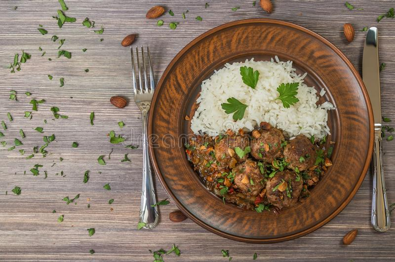 Traditional Italian meatballs Polpette in a ceramic dish with a side dish of rice. The view from the top. Copy-space. royalty free stock photos