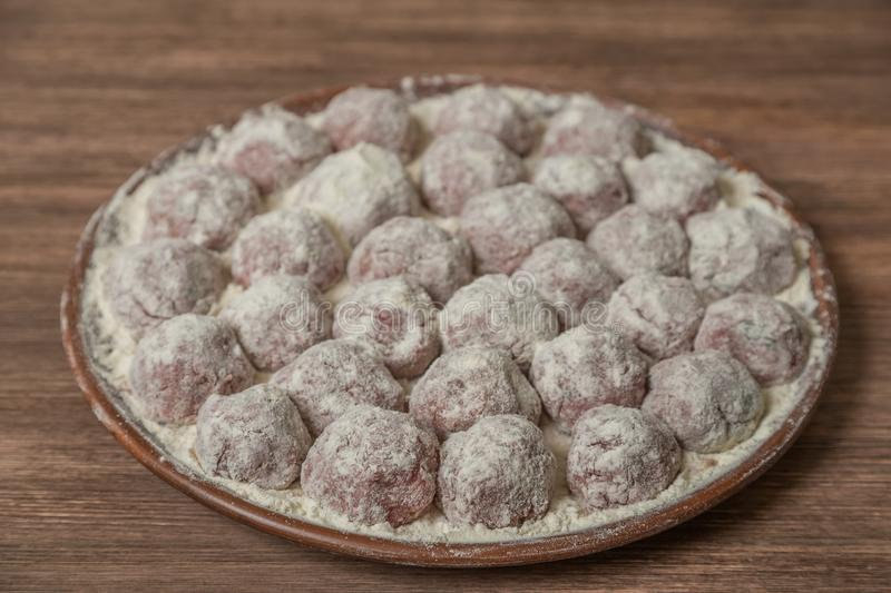 Traditional Italian meatballs Polpette in a ceramic dish with a side dish of rice. The view from the top. Copy-space. royalty free stock photo