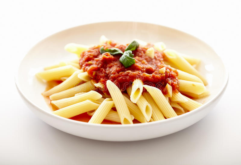 Traditional italian pasta with tomato sauce and basil royalty free stock photos