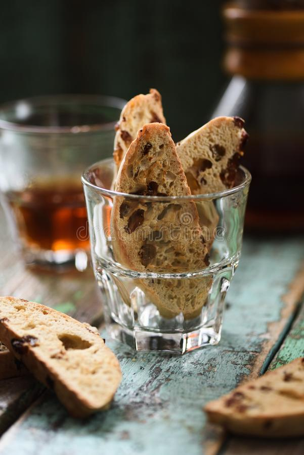 Traditional Italian pastry biscotti or cantucci in glass served with filtered coffee on old shabby wooden background. Side view royalty free stock photos