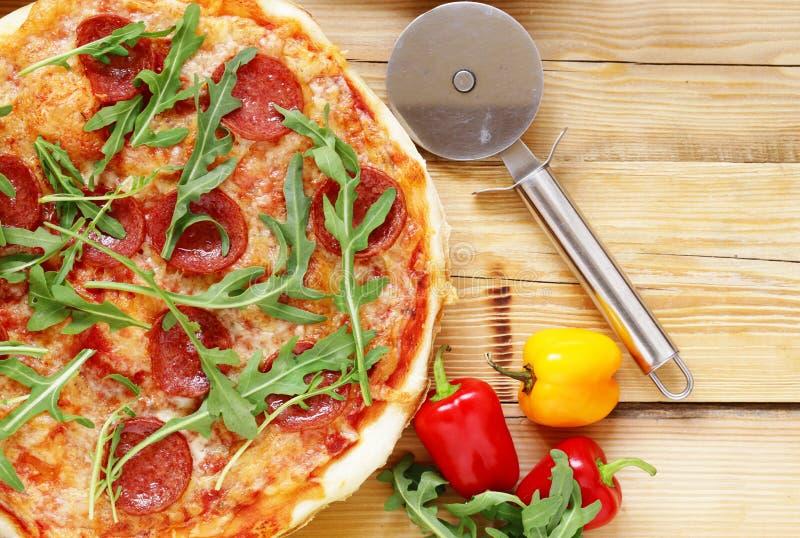 Traditional Italian pepperoni pizza with tomato sauce stock photos