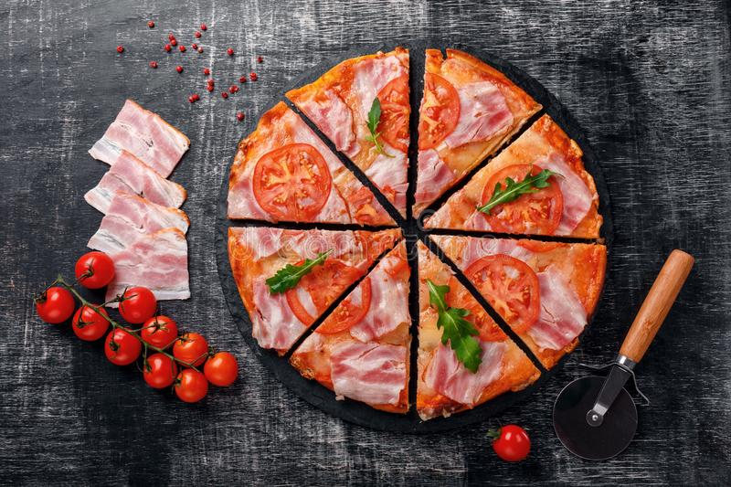 Traditional italian pizza with mozzarella cheese, ham, tomatoes stock images