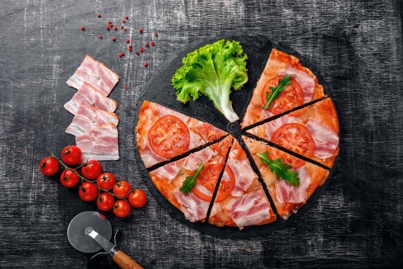 Traditional italian pizza with mozzarella cheese, ham, tomatoes stock photo