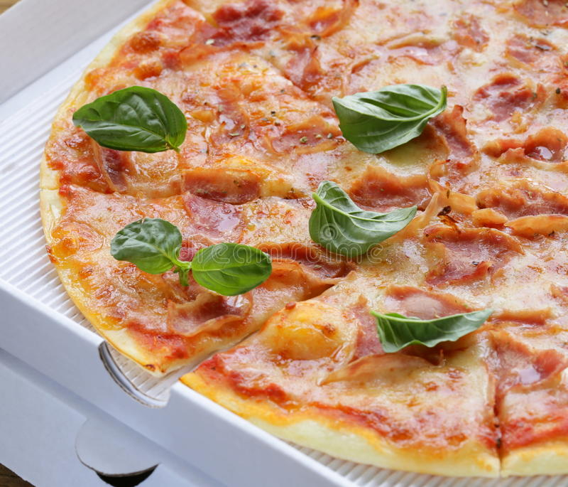 Traditional Italian pizza with prosciutto ham stock photos