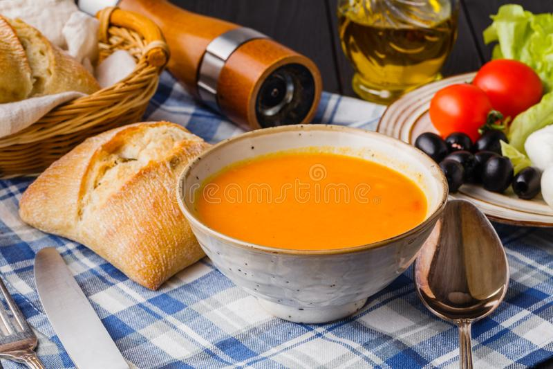 Traditional Italian pumpkin soup, homemade with bread and antipasti royalty free stock image