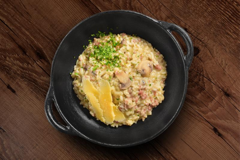 Traditional Italian risotto on black rustic pan royalty free stock photo